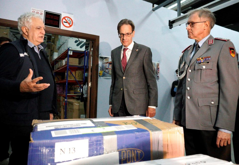 The German military attaché and the German ambassador to Georgia hand over the delivery of materials for SARS-CoV-2 diagnostic to the director of the NCDC (from right to left).